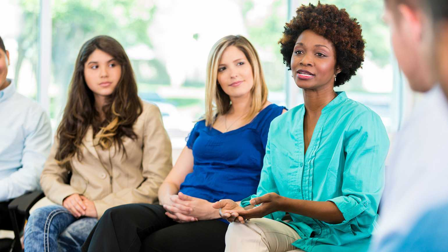 A woman speaking out in a support group.