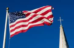 American flag and a church steeple (Thinkstock)