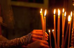 Lighting candles in a church. Photo: Thinkstock.
