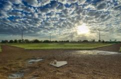 Muddy baseball field. Photo: Thinkstock.
