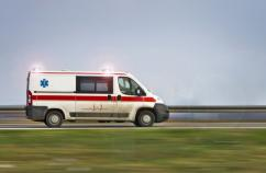 ambulance with lights flashing speeding down the highway