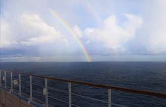 A cruise to Canada with a rainbow in the background