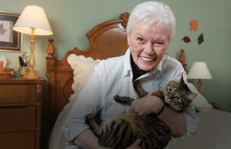 Mary and her cat, Rainbow, who plays fetch like a dog