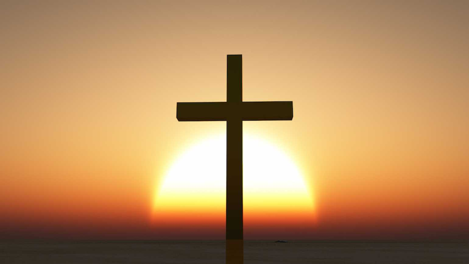 Cross at dawn. Thinkstock.