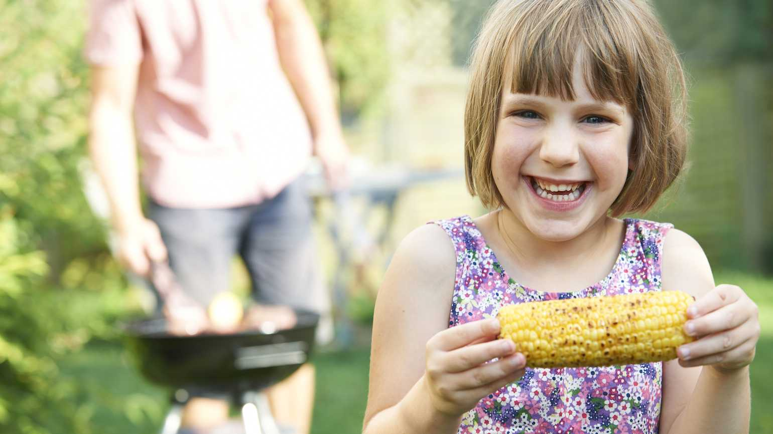 Eating an ear of corn at the end of summer