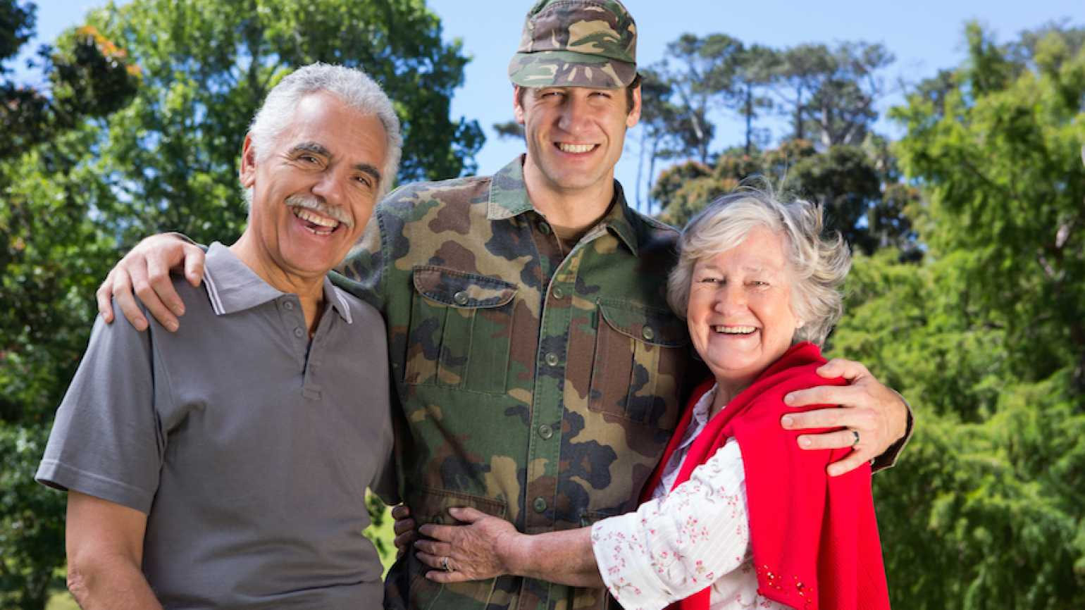 Parents with their soldier son.