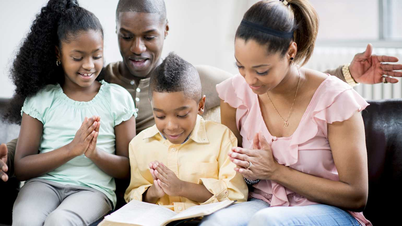 A family celebrates Trinity Sunday.
