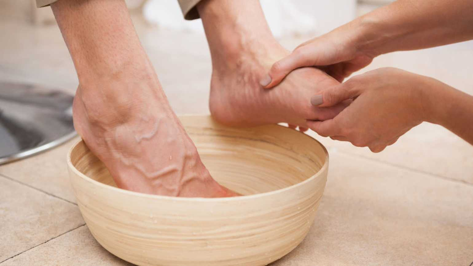 A woman's foot being washed. Photo from 123RF(r).