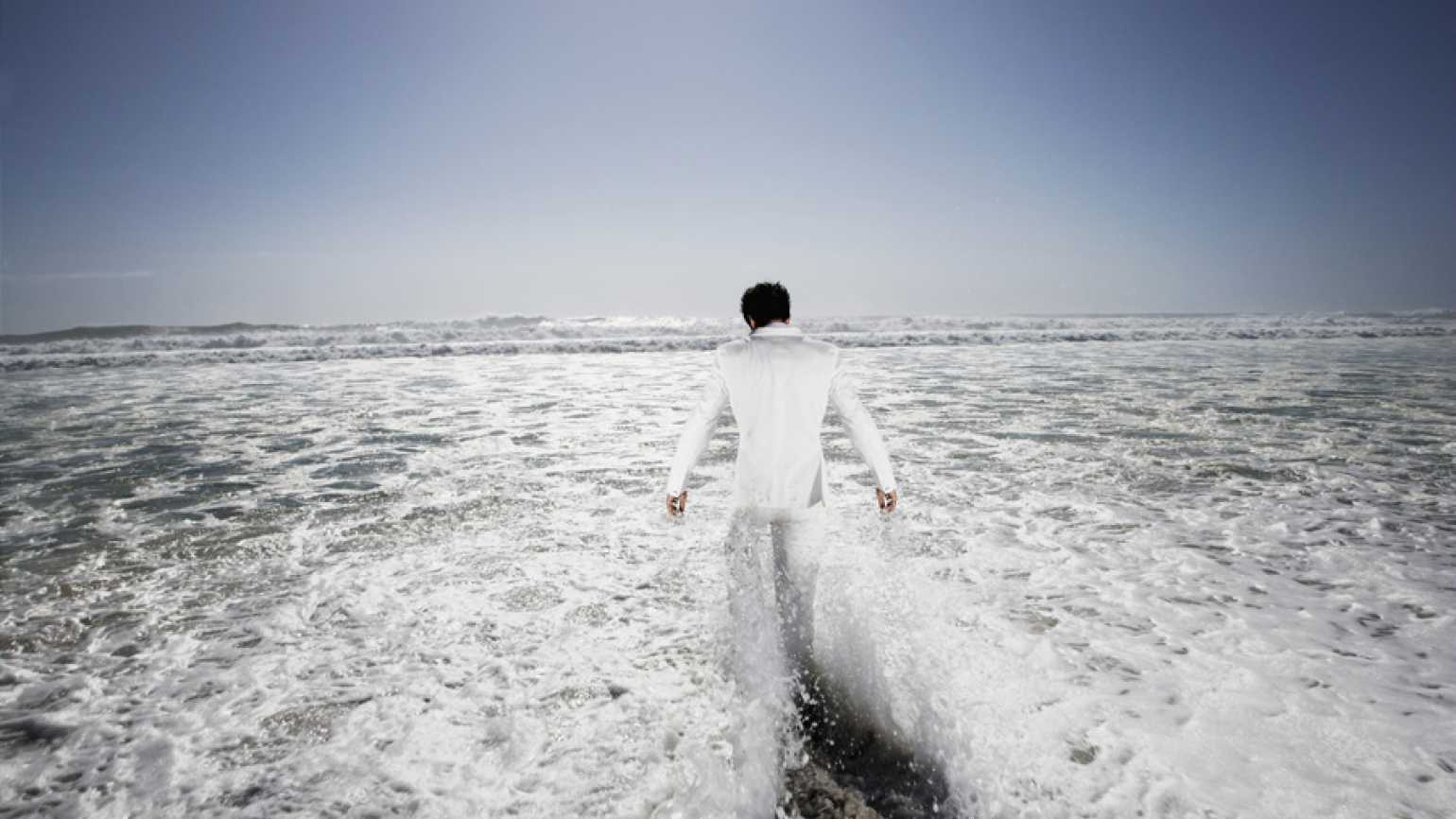 Man walking into the ocean