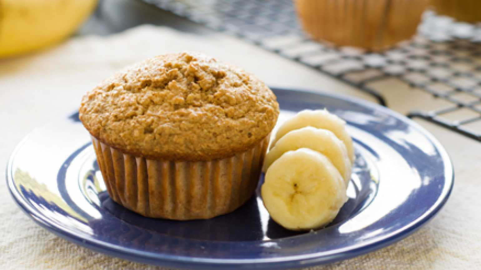 Banana muffin with banana slices beside it