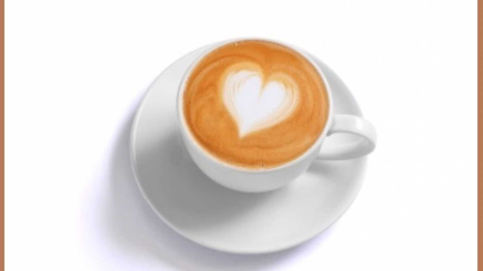 Coffee cup with a heart-shape made from cream