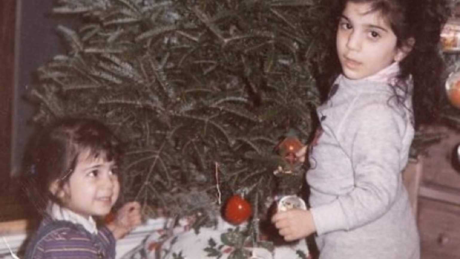 Mysterious Ways associate editor Diana Aydin trimming the tree at age 3.