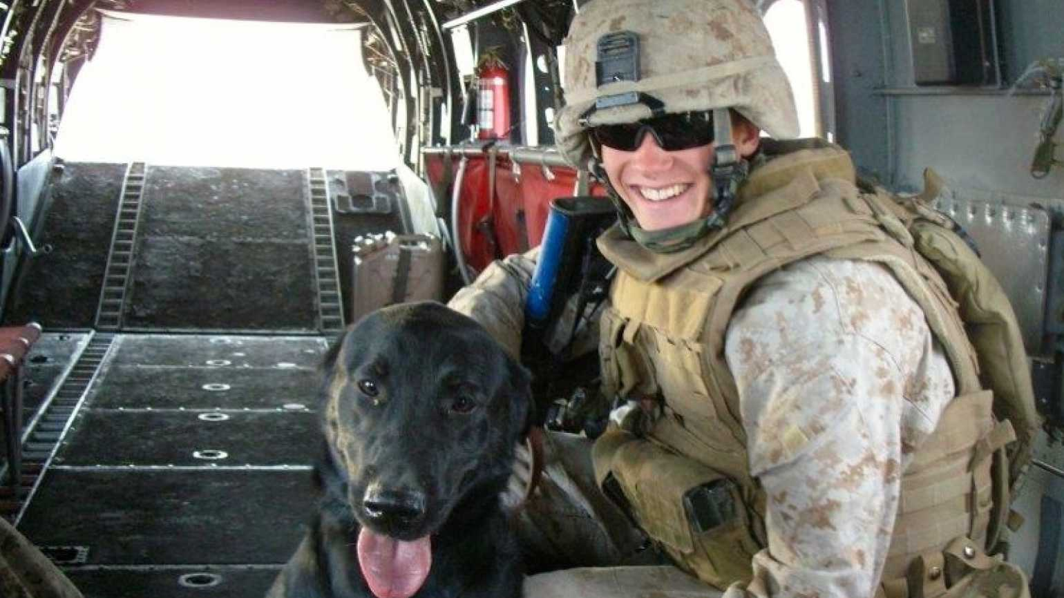 Outreach Ministries blogger Edie Melson's Marine son, Jimmy, and dog Seger