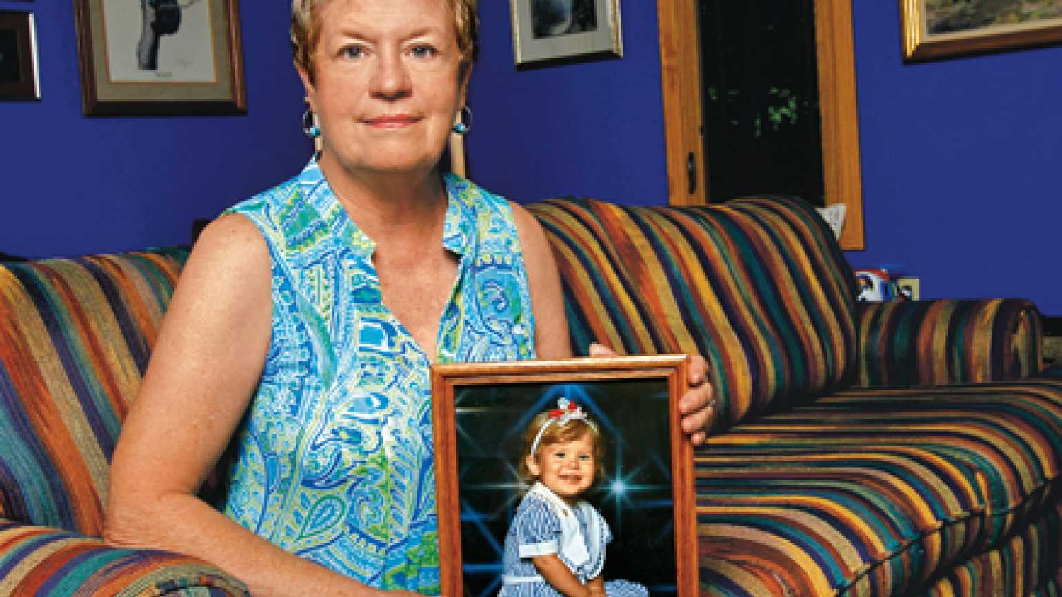 Julie Burns with a photograph of her granddaughter Paige