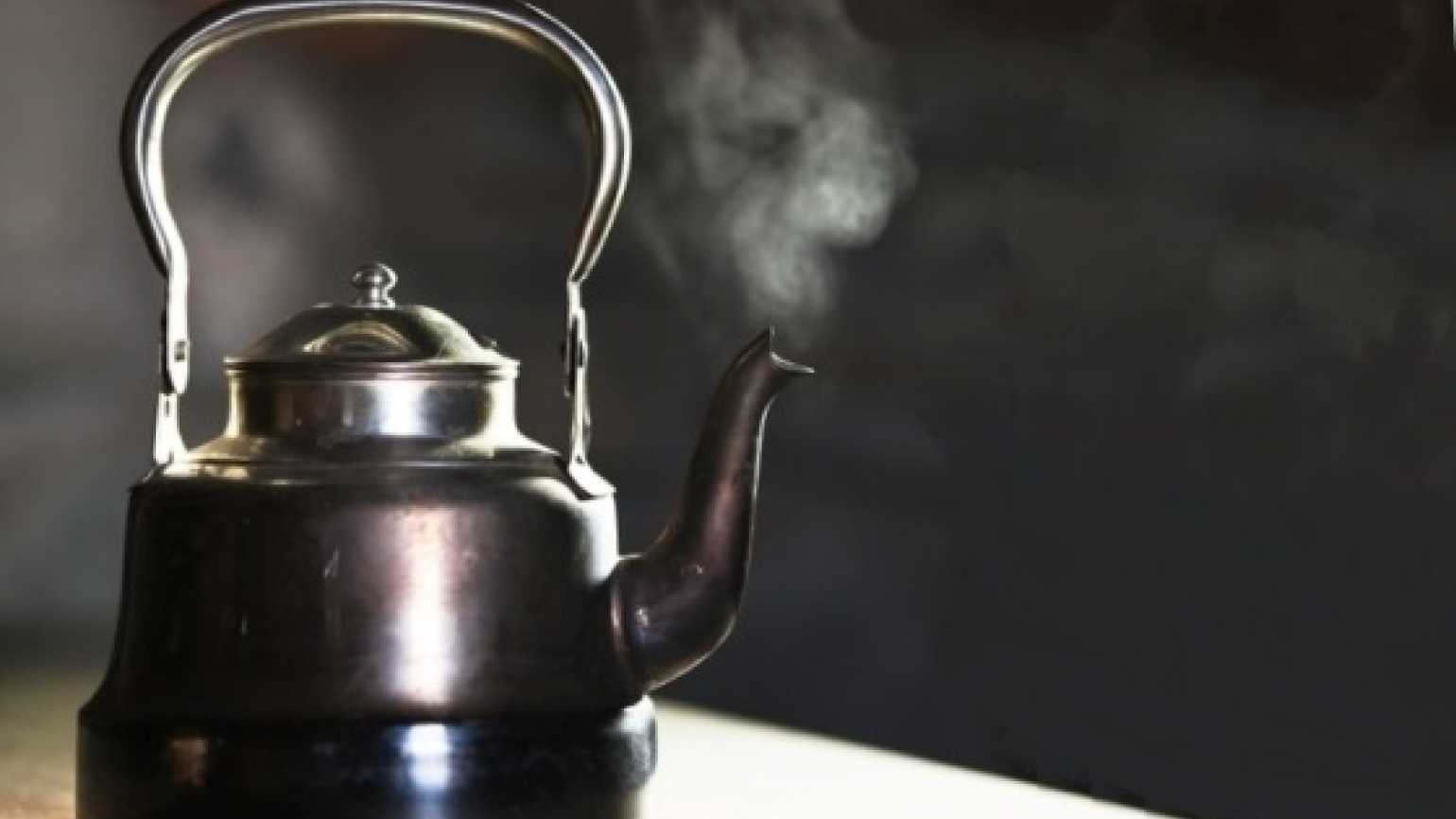 steam rising from a boiling tea kettle
