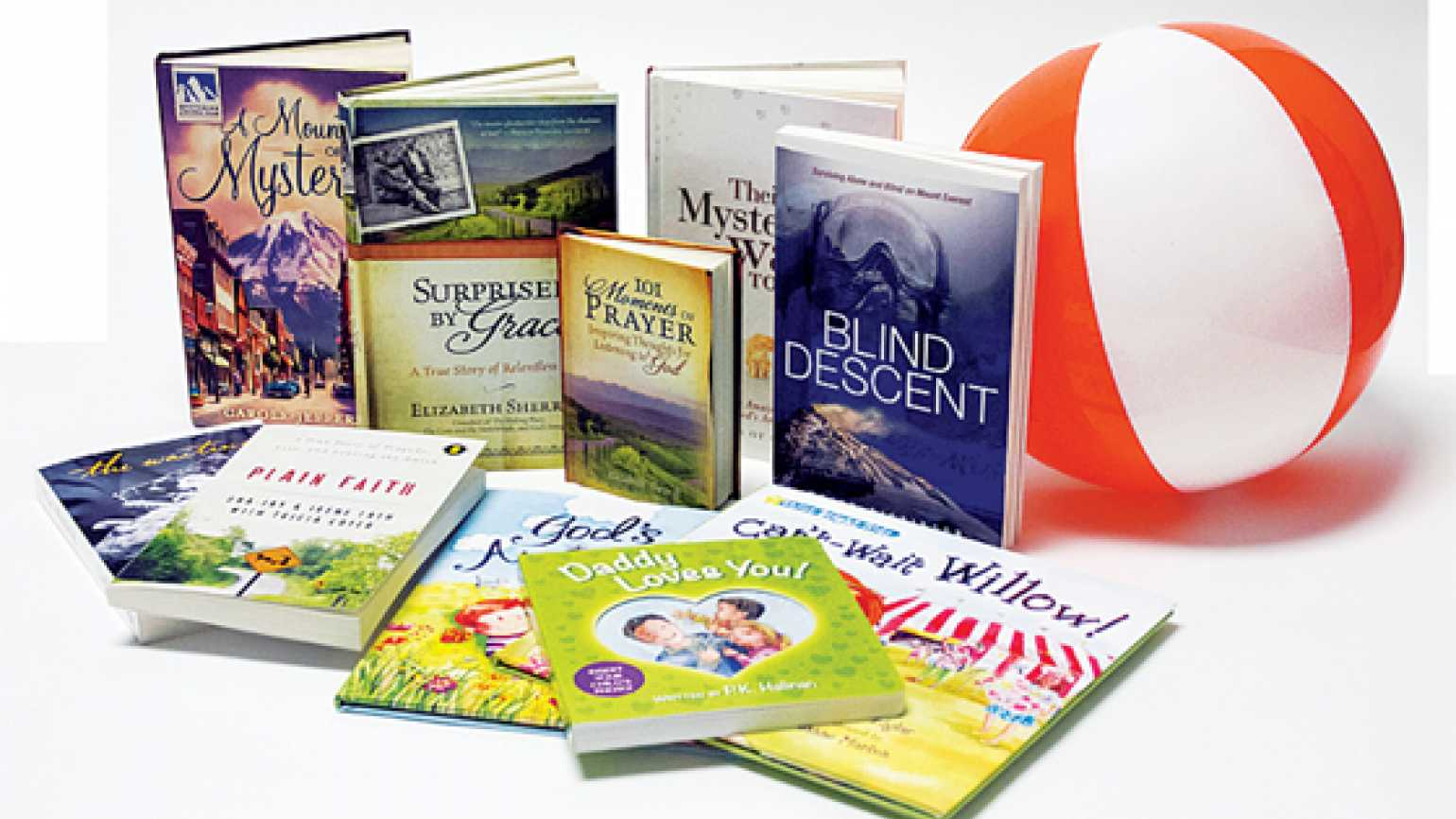 Some Summer Reading titles from Guideposts Books and a beach ball