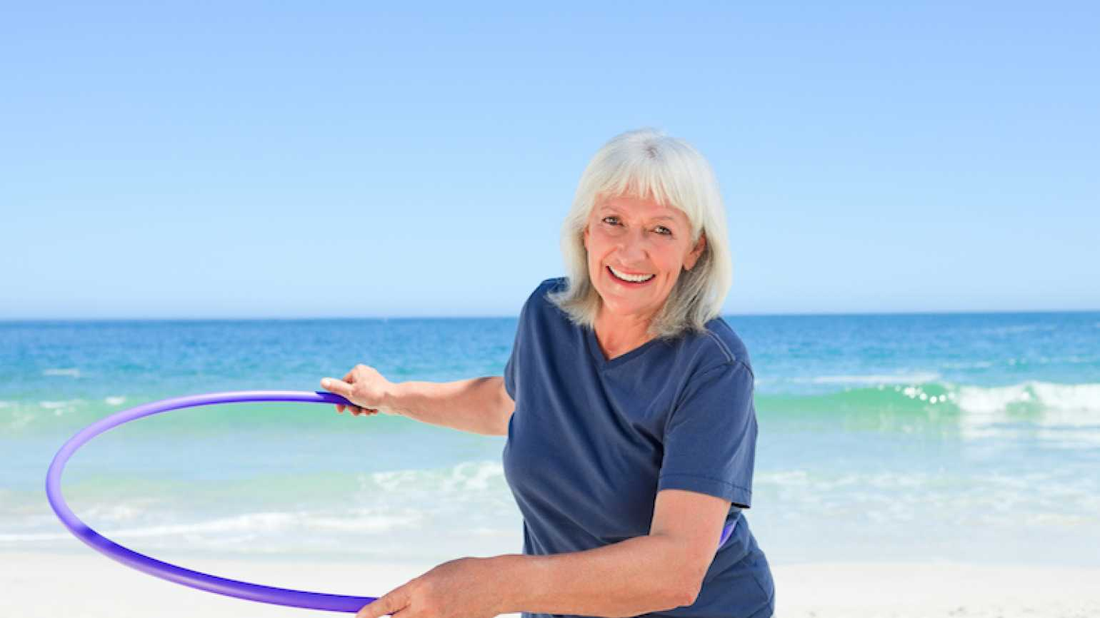 Photo of woman with hula hoop by Wavebreak Media for Thinkstock