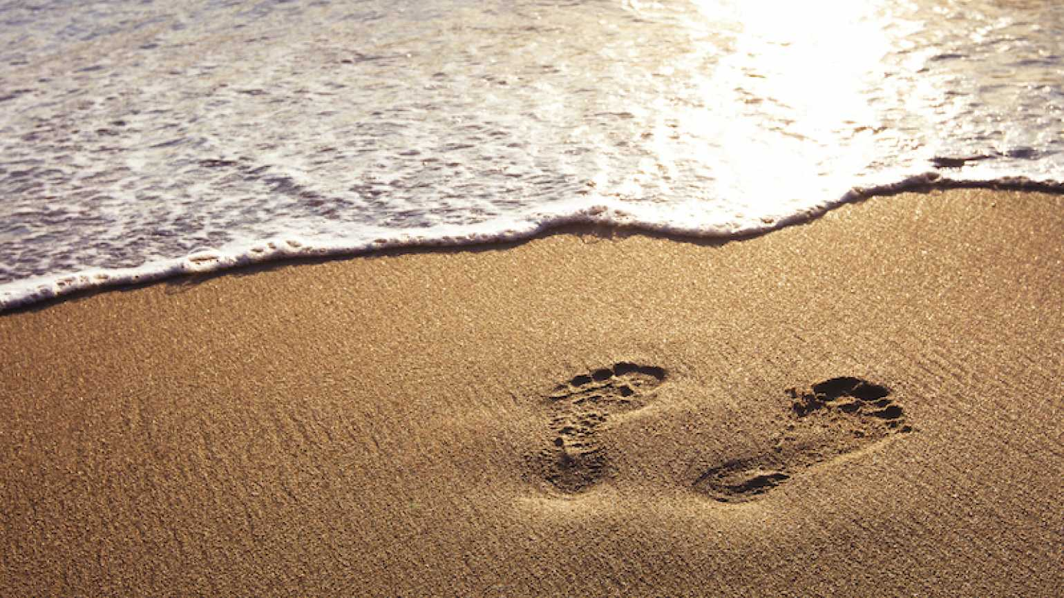 Footprints in the sand. Photo by Anya Berkut, Thinkstock.