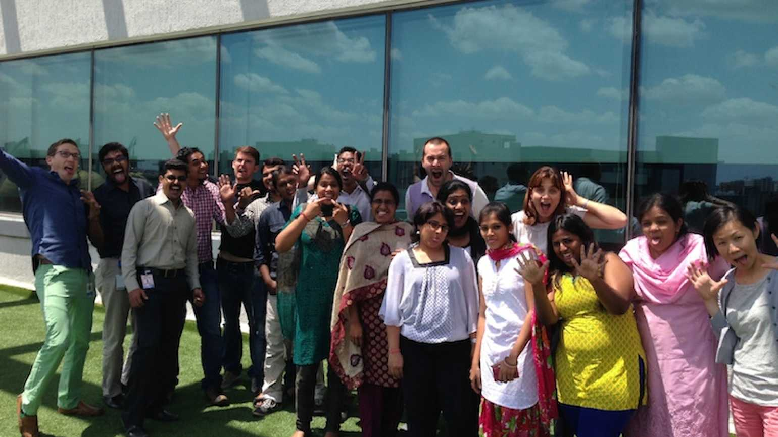 Rick Hamlin's son, far left in green pants, with the LinkedIn team in India