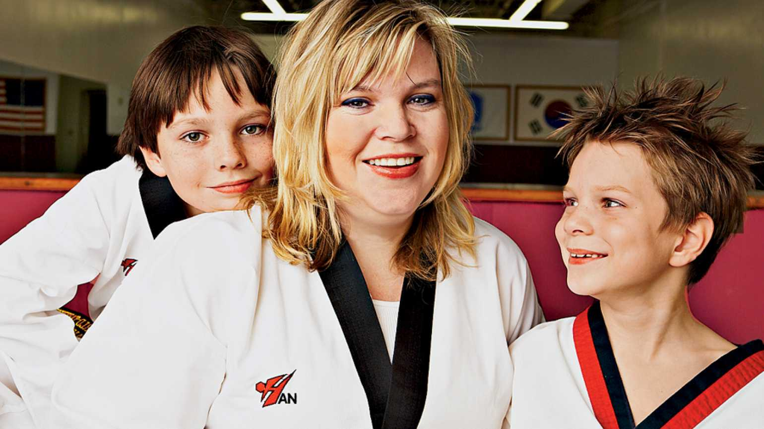 Bridgette Mitcheff at the Tae Kwon Do studio with Alec and Zachariah