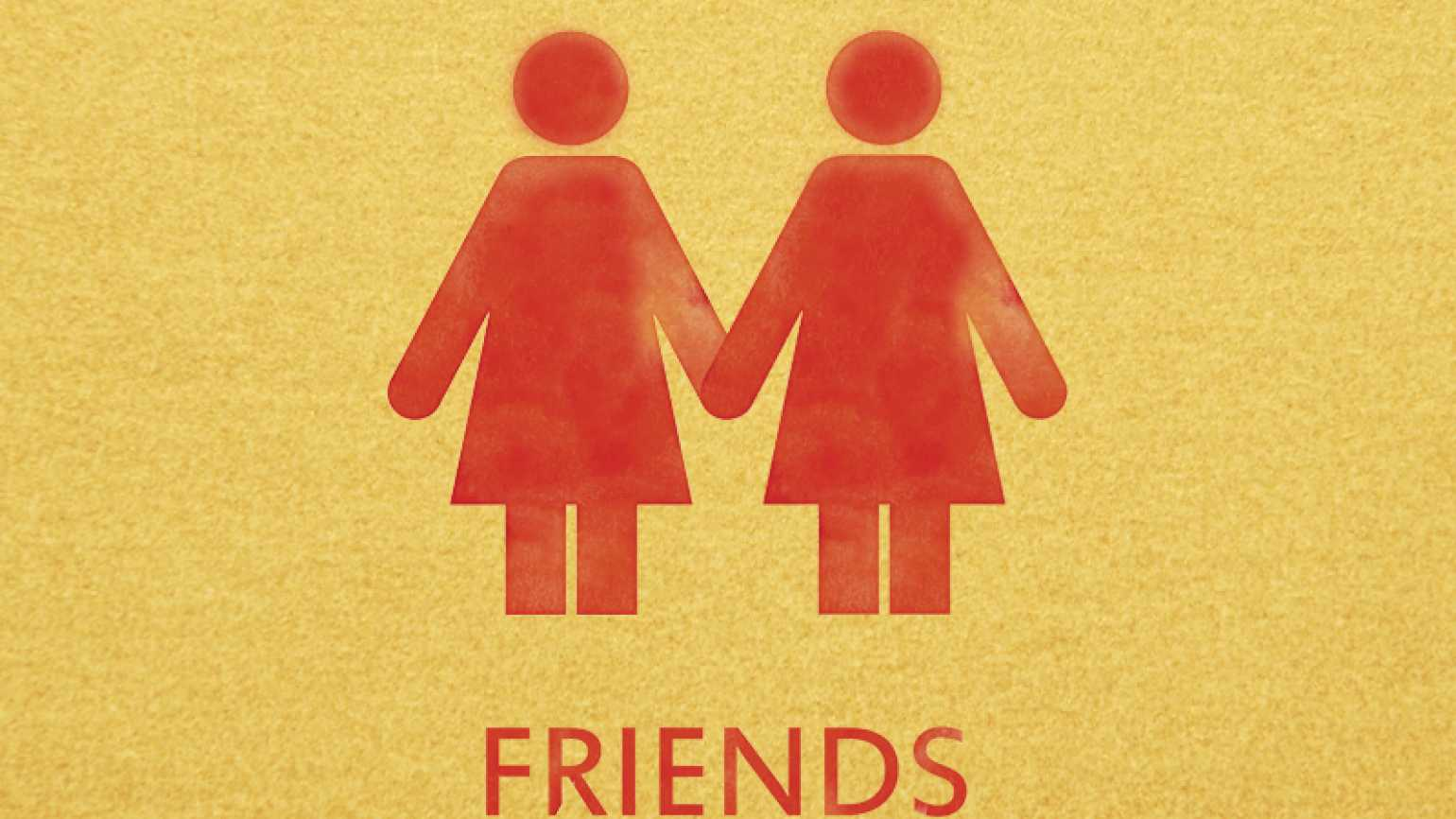 A bathroom door sign reading Friends with two female stick figures holding hands