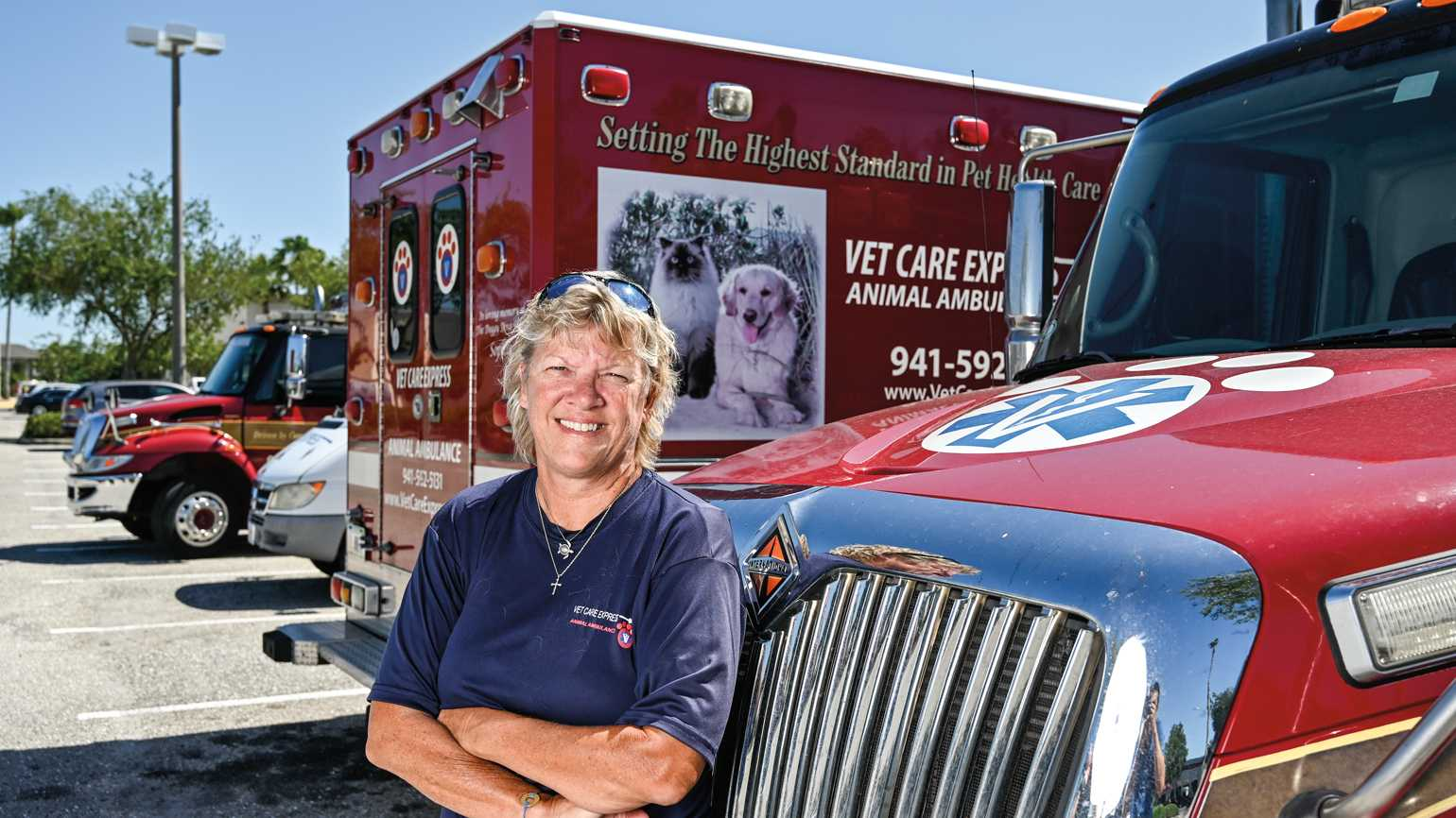 Cheryl Brady with her Vet Care Express ambulance mobiles.