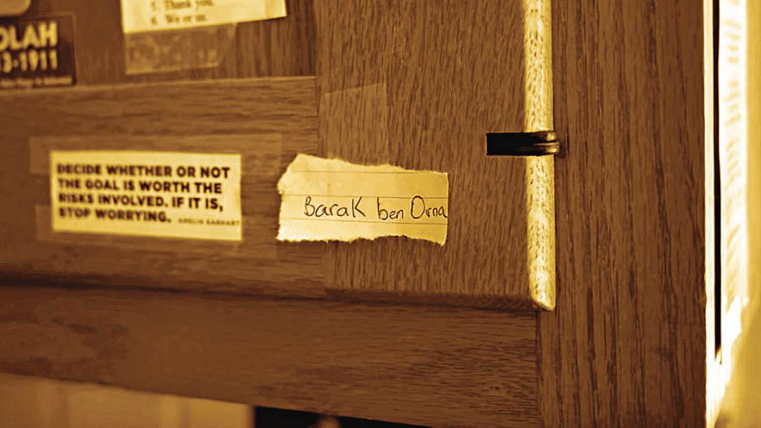 Barak ben Orna's name on a scrap of paper taped to a kitchen cabinet