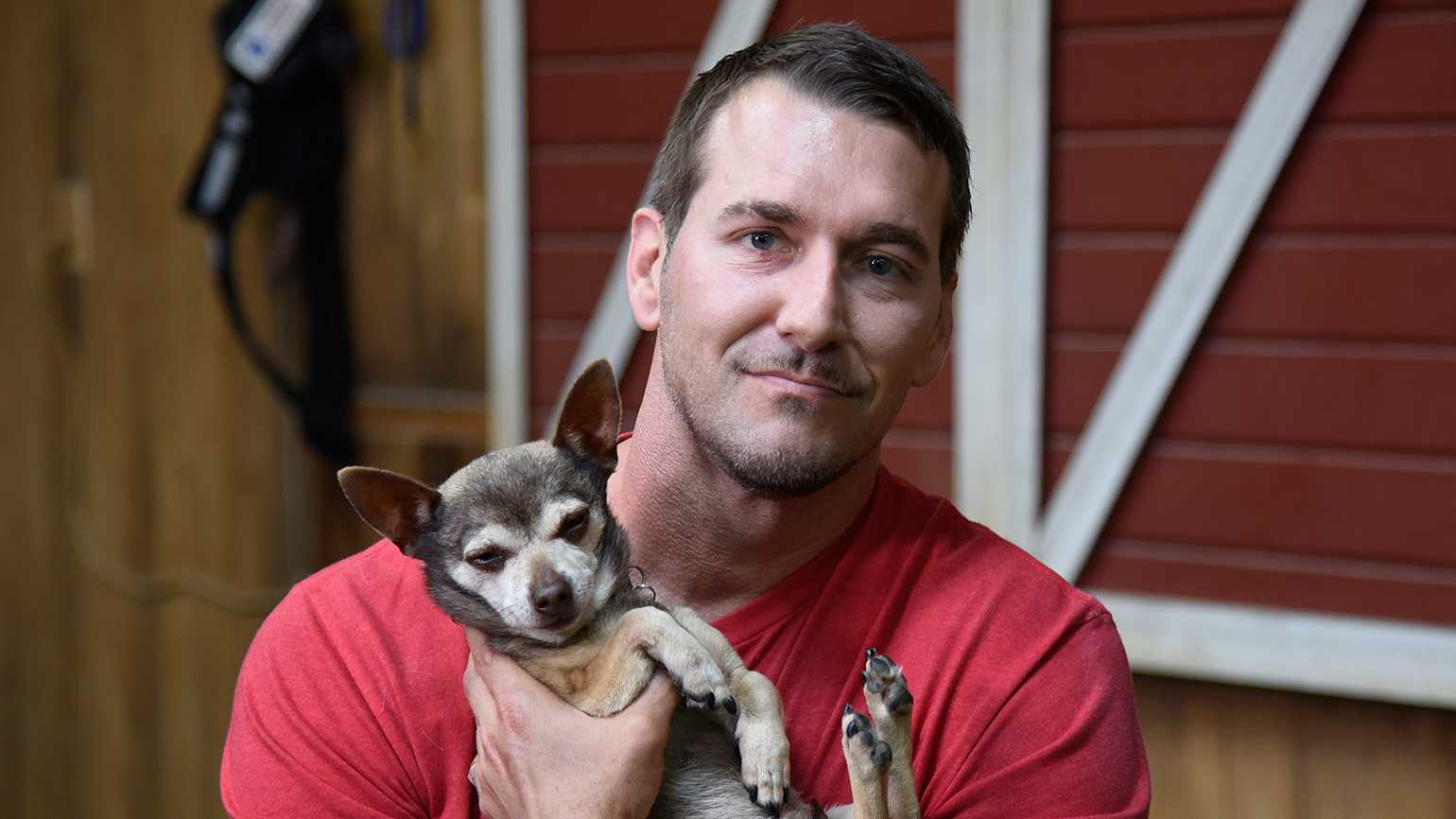 Lucky Dog host Brandon McMillan and a canine friend