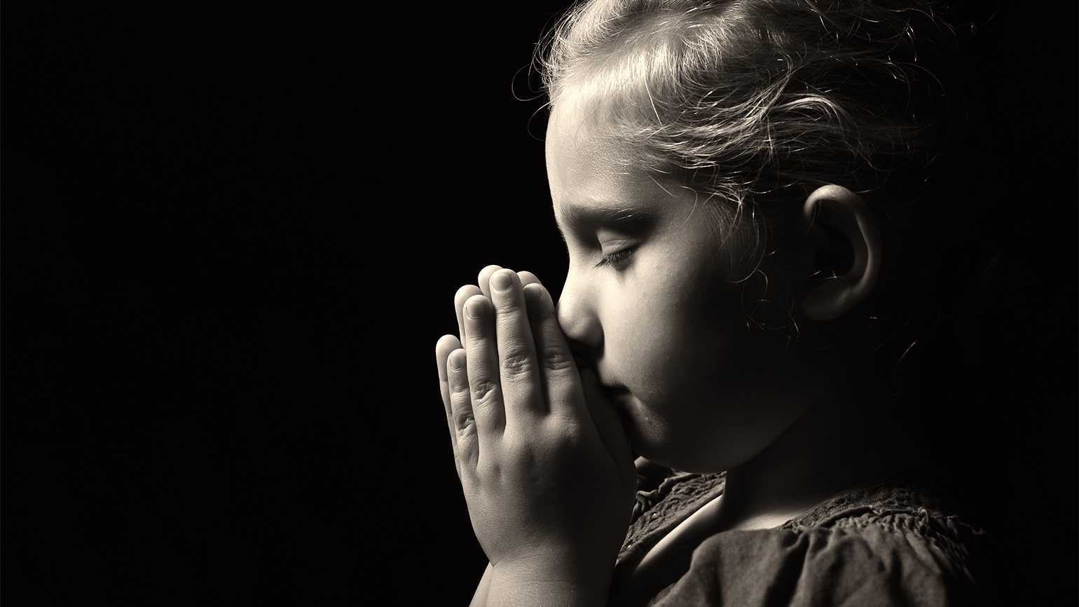 A small child prays
