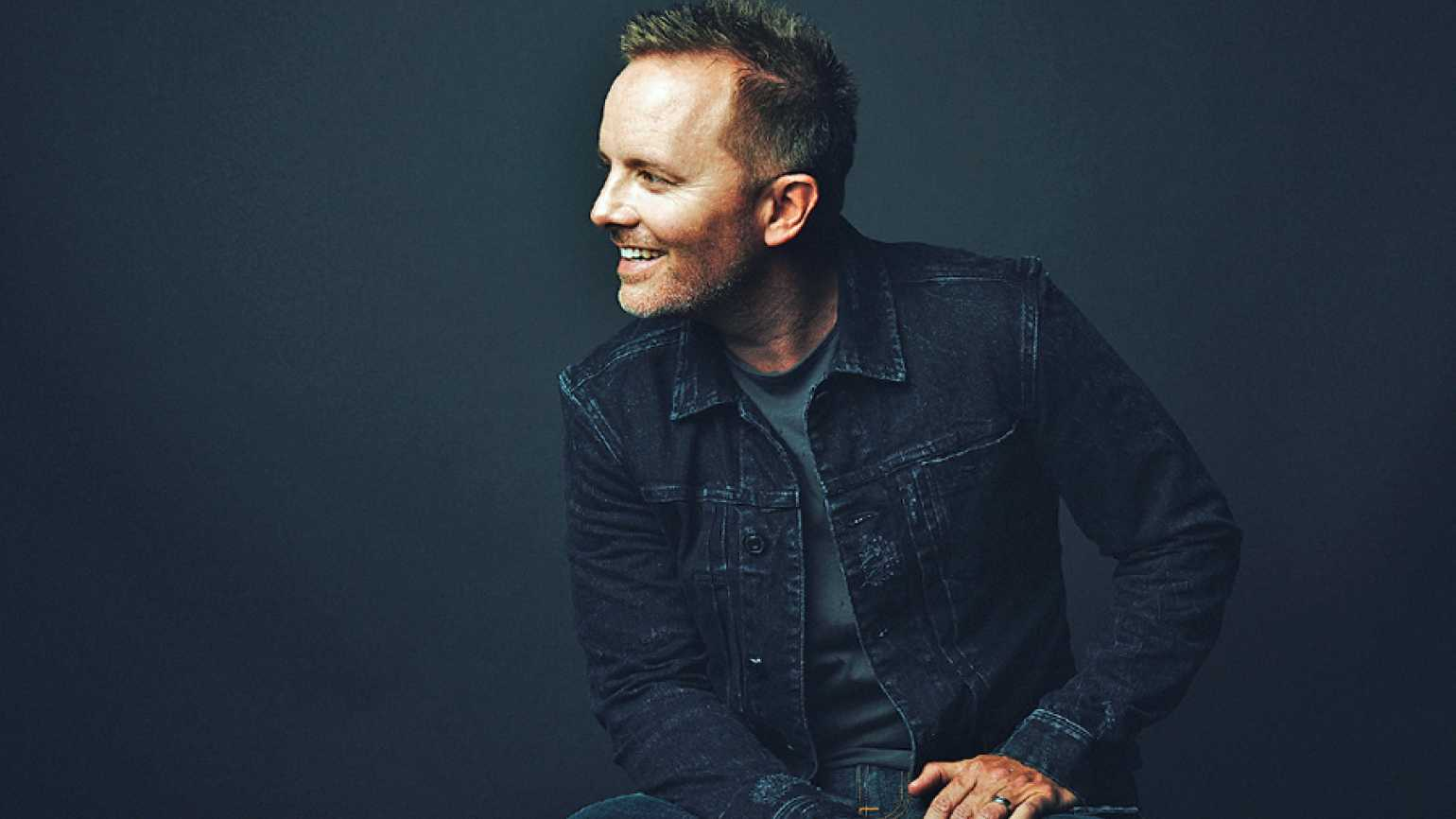 chris tomlin is singing the good news on adore