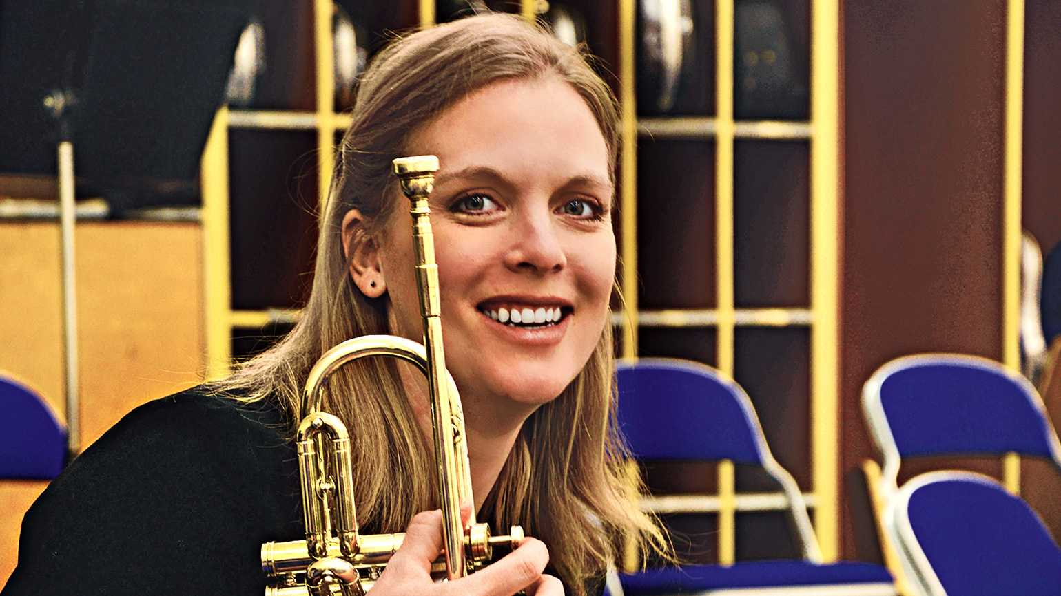 Erin, trumpet in hand, pauses during band rehearsal