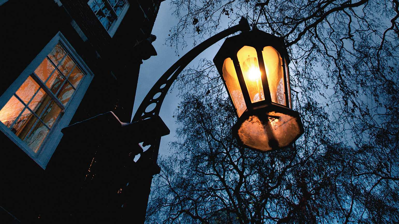 A street lamp shines in the wee hours of the night