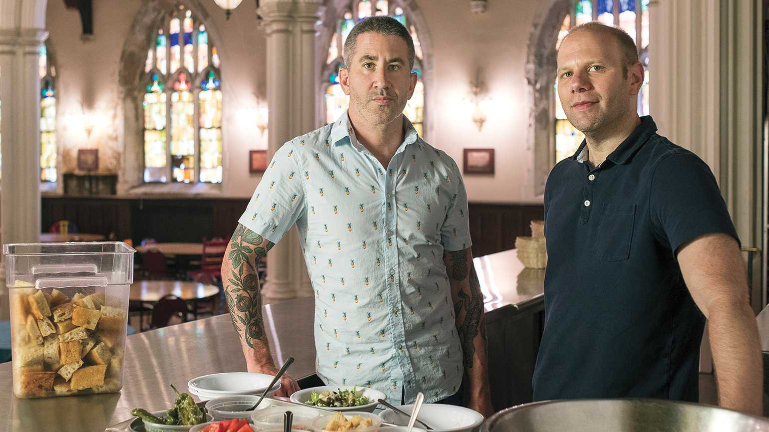 Michael (left) and his business partner, Steven Cook, at Broad Street Ministry in Philadelphia