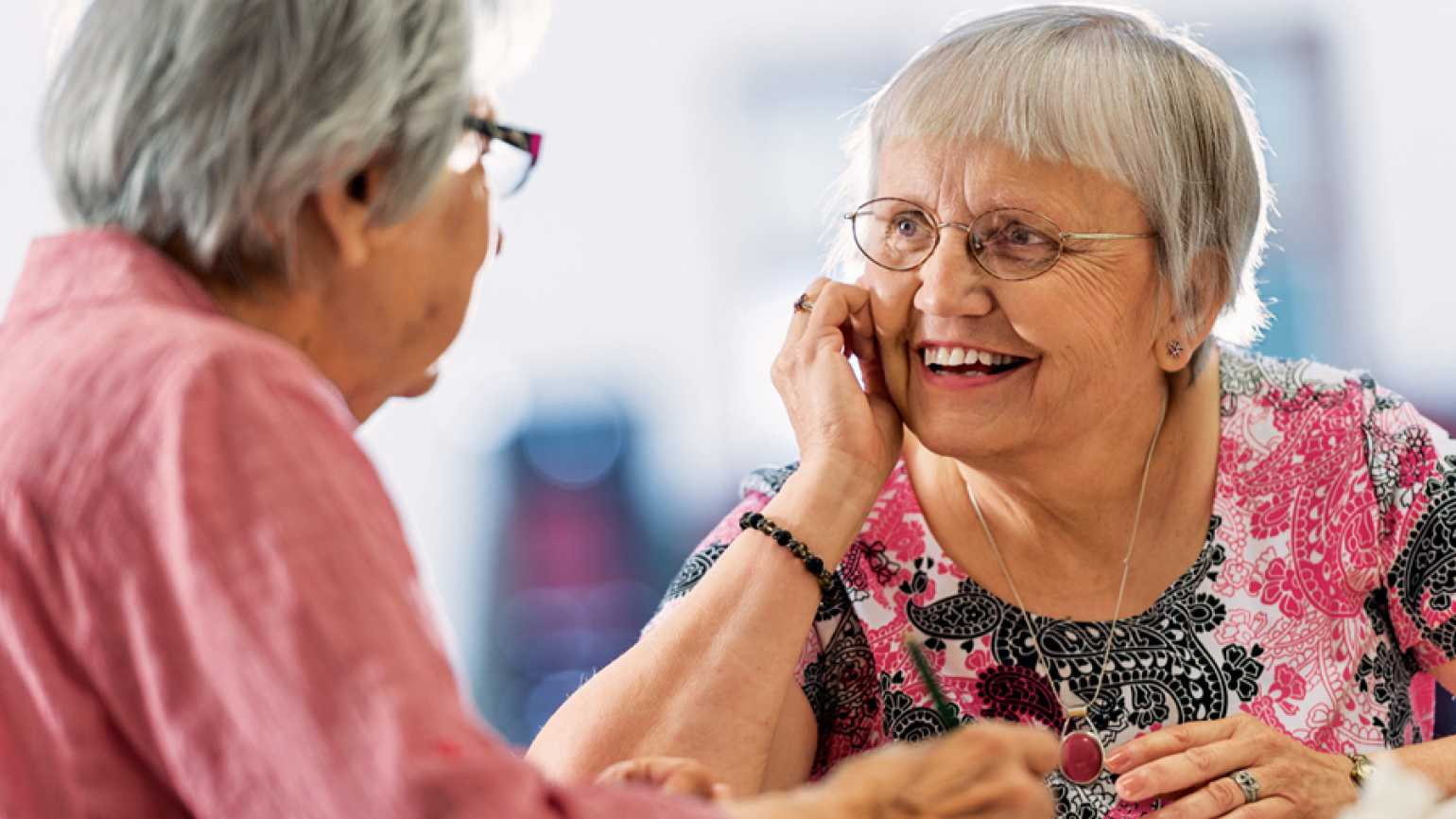 Guideposts: Sharon Vander Waal spends time with a resident at the Gathering Place.