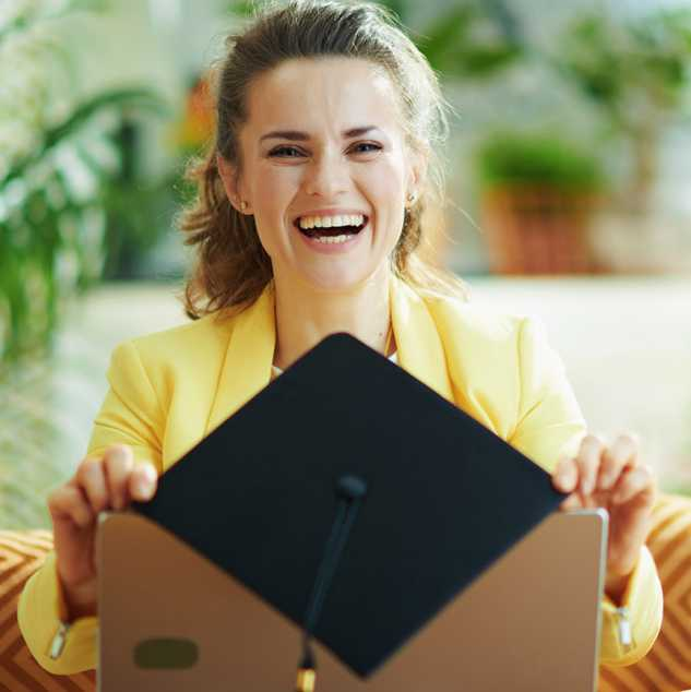 Young woman celebrating her graduation virtually