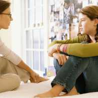 Mother and teen daughter talking about problems with attitude and depression, Guideposts