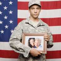 Guideposts: Soldier holding photo of his family.