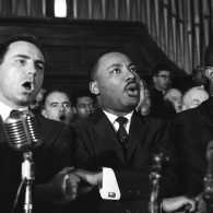 Martin Luther King Jr., Ralph Abernathy (far right) and unidentified men sing in a Selma, Alabama church.
