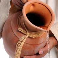 Jesus pours water from a clay pot