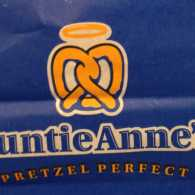 Auntie Anne's pretzel bag, with a halo over a pretzel looking like angel wings