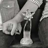Ben Nunery and daughter Olivia with a glass angel; photo by Melanie Tracy Pace