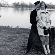Susan's dad in uniform, posing by a lake with her mom