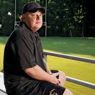 Bill Courtney sits in the empty stands at his football team's practice field.