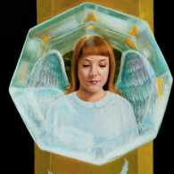 An artist's rendering of an angel reflected in a glass doorknoob