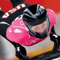 Katie Uhlaender speeds down the track at the 2006 Winter Olympics in Turin.