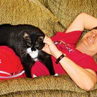 Lori's husband, John, and their cat Tootsie