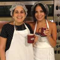 Diana and her sister Kristin wait for the bread to bake.