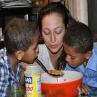 Karen Valentin and her two sons cooking dinner