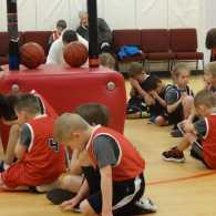 Basketball players in prayer after a game. Photo by Michelle Cox.