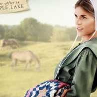 An Amish girl leaning against a tree, from the cover of Miriam's Quilt